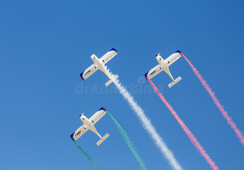 Disabled Italian pilots aerobatic team Wefly forms the colors of Italian flag royalty free stock image