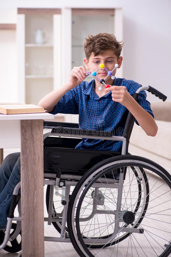 Disabled kid preparing for school at home. The disabled kid preparing for school at home royalty free stock photography