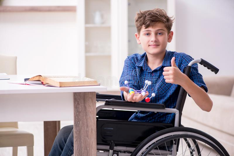 Disabled kid preparing for school at home. The disabled kid preparing for school at home royalty free stock photos