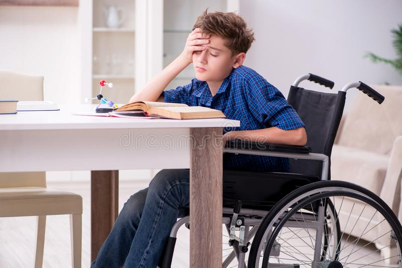Disabled kid preparing for school at home. The disabled kid preparing for school at home stock photography