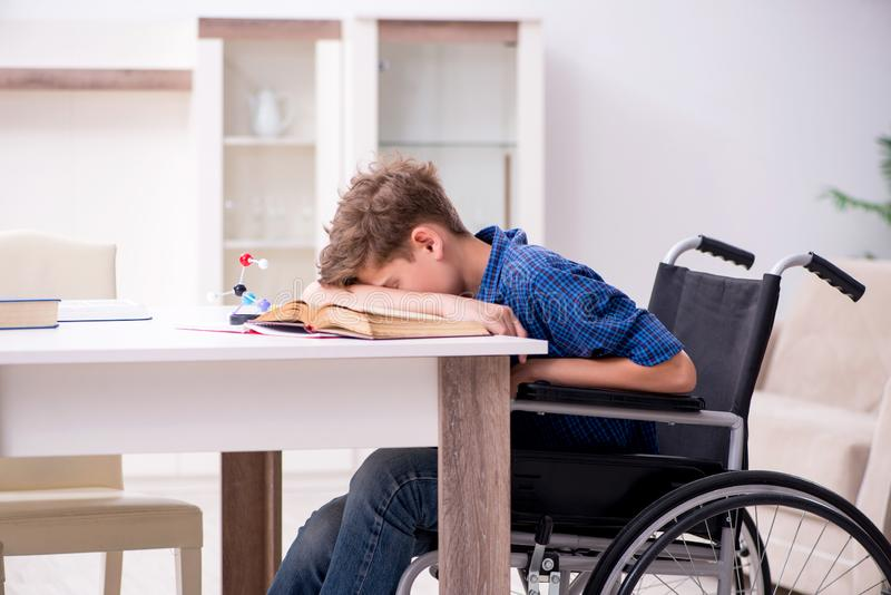 Disabled kid preparing for school at home. The disabled kid preparing for school at home royalty free stock images