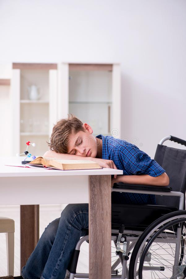Disabled kid preparing for school at home. The disabled kid preparing for school at home stock photos