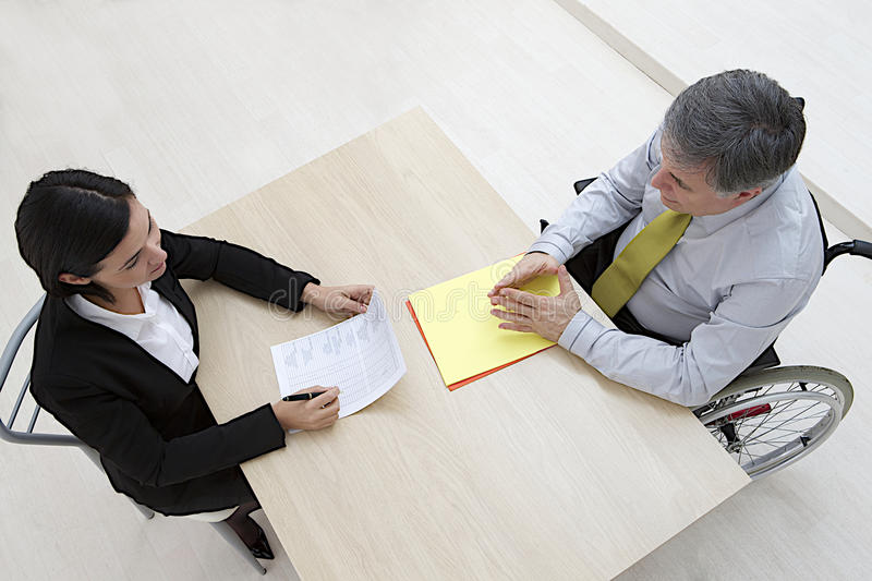 Disabled male candidate in job interview stock image