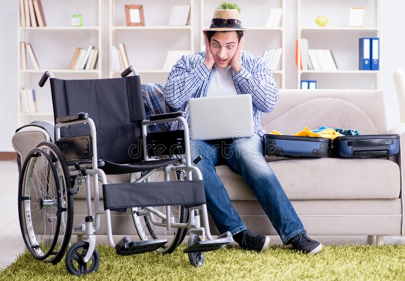 Disabled man booking travel online using laptop computer royalty free stock photos