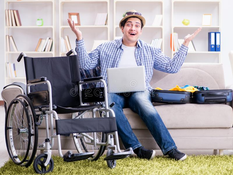 Disabled man booking travel online using laptop computer. The disabled man booking travel online using laptop computer stock photo