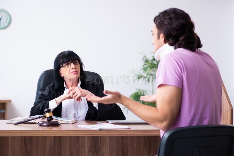Disabled man consulting judge for damages litigation. The disabled man consulting judge for damages litigation stock photography