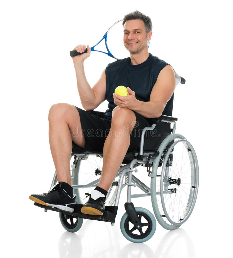 Disabled man holding racket and ball royalty free stock photos