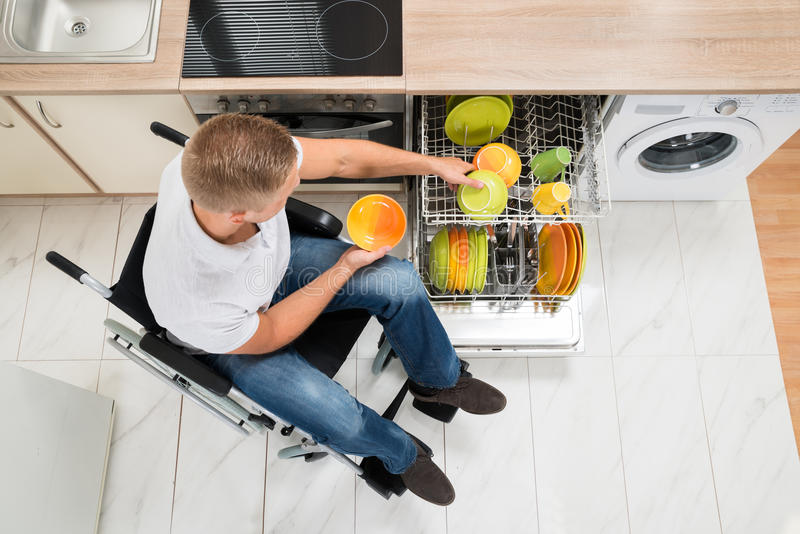 Disabled man in kitchen royalty free stock photos
