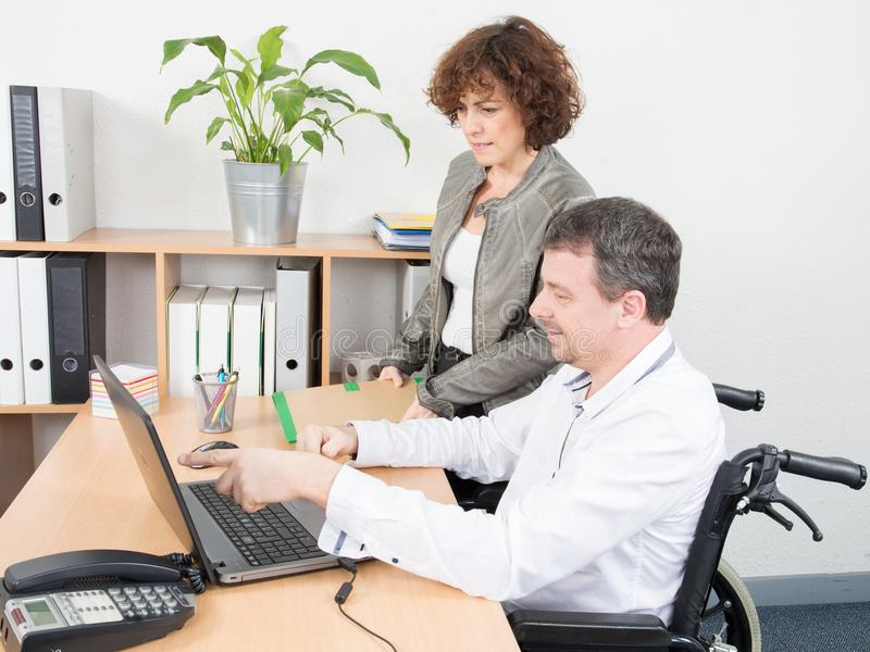 disabled man office worker in a wheelchair royalty free stock images