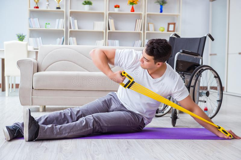 The disabled man recovering from injury at home. Disabled man recovering from injury at home royalty free stock image