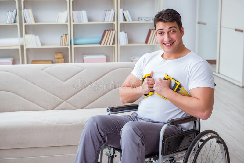The disabled man recovering from injury at home. Disabled man recovering from injury at home royalty free stock photography