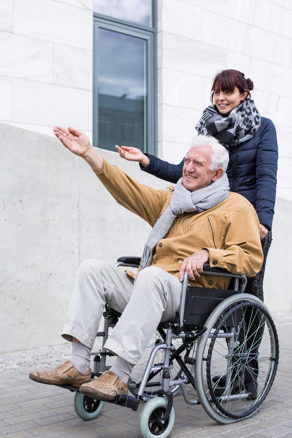 Disabled man spending time outdoors royalty free stock photo