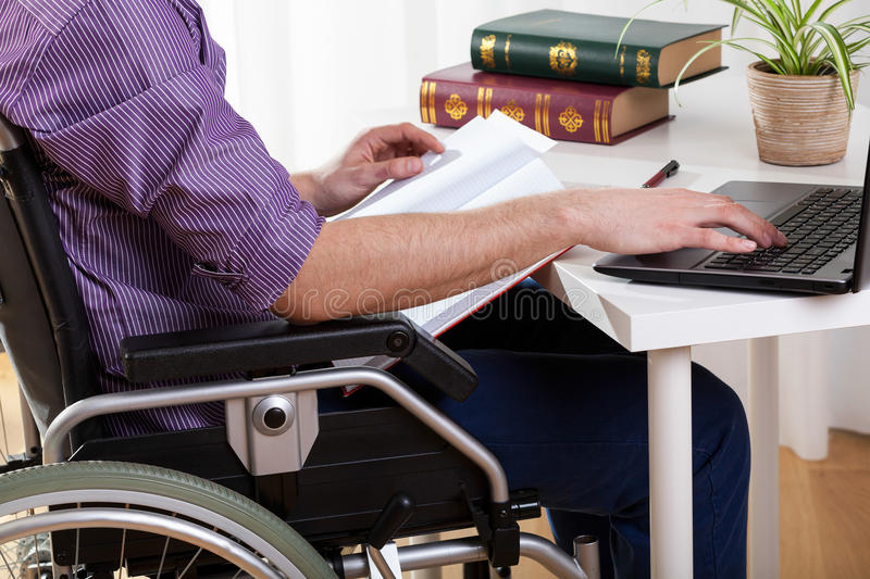 Disabled man studying at home royalty free stock photos