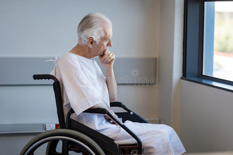 Disabled man on wheelchair stock image
