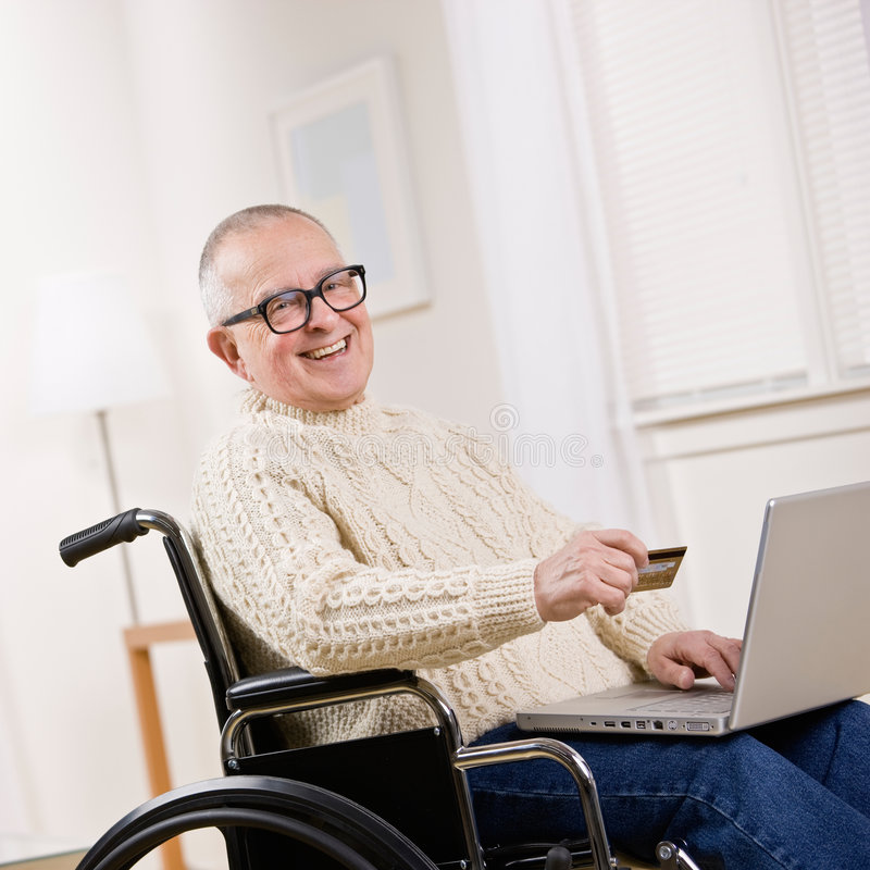 Download Disabled Man In Wheelchair Using Credit Card Royalty Free Stock Photo - Image: 6599445