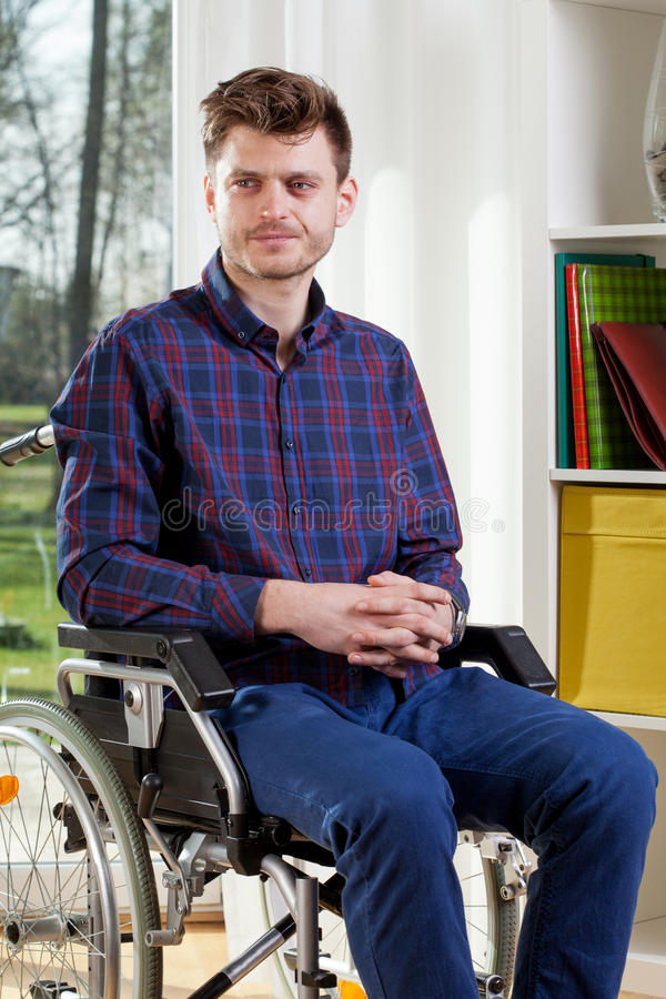 Disabled man on wheelchair royalty free stock image