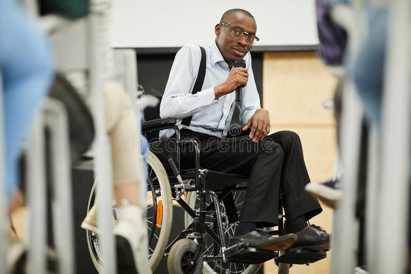 Disabled motivational speaker at conference stock photos