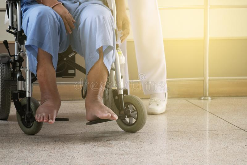 Disabled Old Man on an Electric Wheel chair in the Hospital wit royalty free stock images