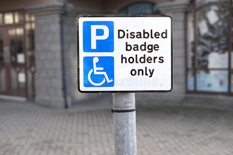 Disabled Badge Holders Only at Car Park No Unauthorised Parking royalty free stock photography