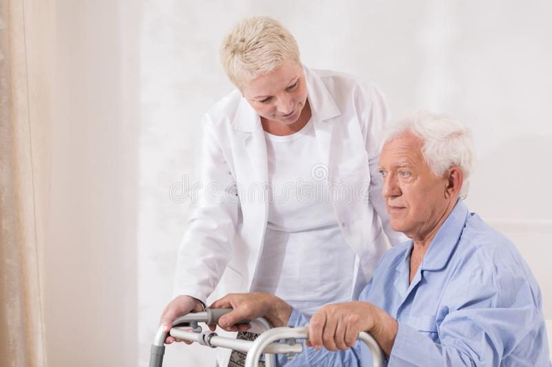 Disabled patient with walking zimmer. Image of disabled old patient with walking zimmer royalty free stock images