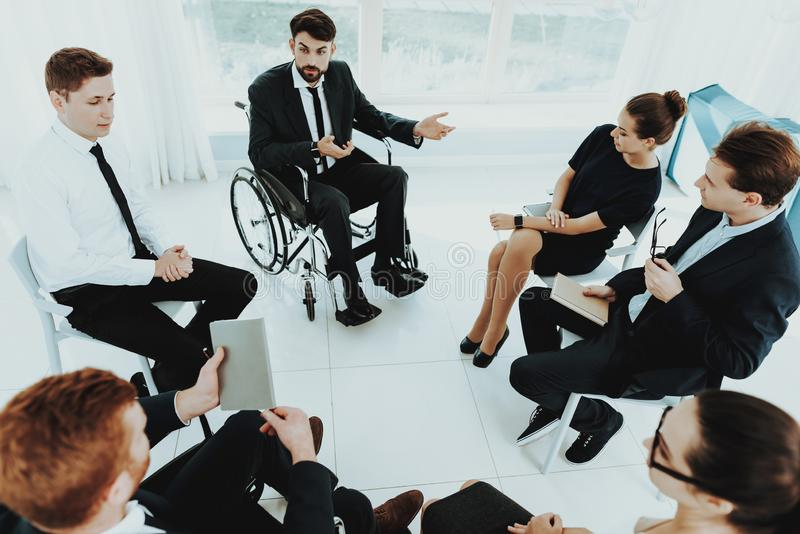 Disabled People Discuss Concept Work at Office. Person in Wheelchair. Healthy Person and Disabled. Panoramic View. Bright Interior. People with Limited stock images