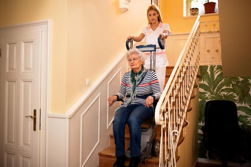 Disabled people needs professional help. Care concept at nursing home stock image