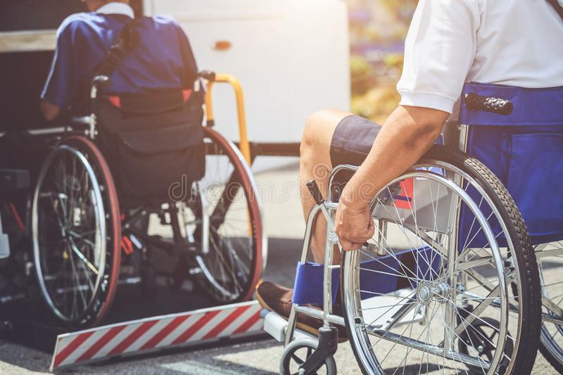Disabled people sitting on wheelchair and going to the public bu. Disabled bus concept : Disabled people sitting on wheelchair and going to the public bus stock photography
