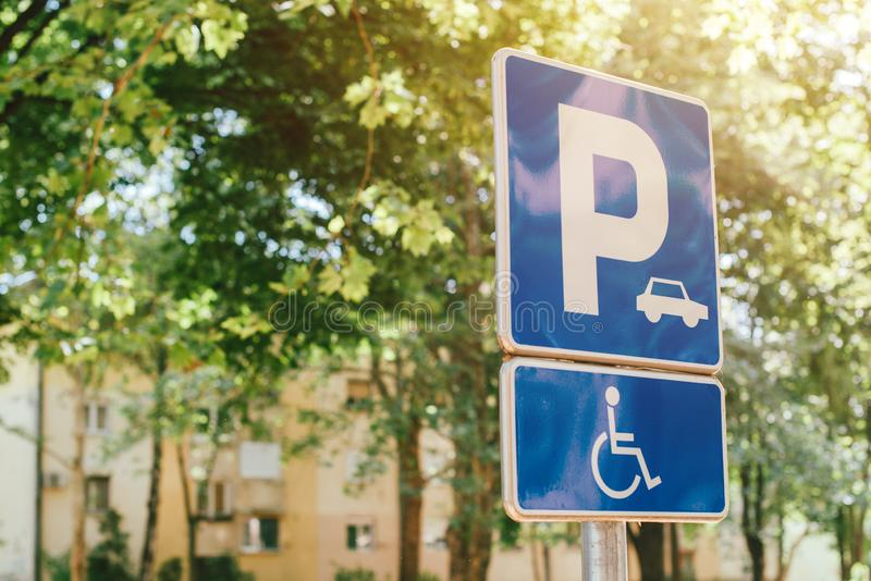 Disabled person parking spot sign, reserved lot space stock image