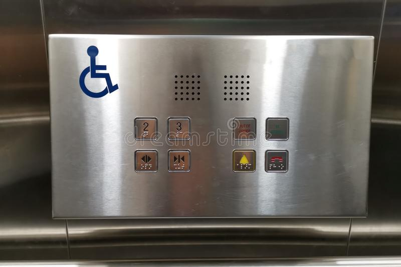 Disabled person sign in the elevator lift, Symbol for disabled people in public buildings.  royalty free stock photos