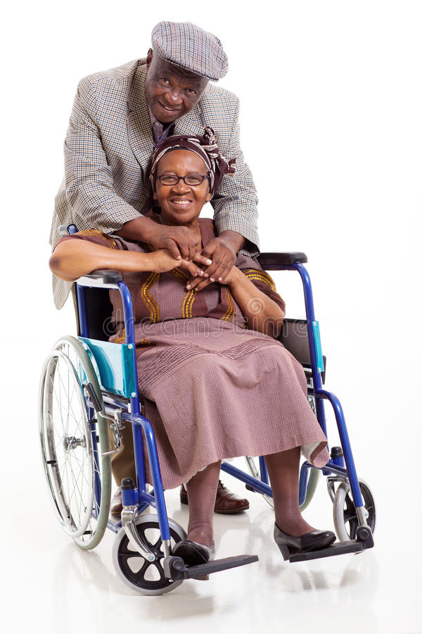 Disabled senior african woman husband royalty free stock photography
