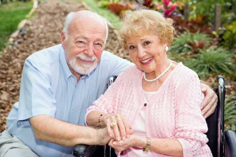 Disabled Senior Couple Outdoors stock photography