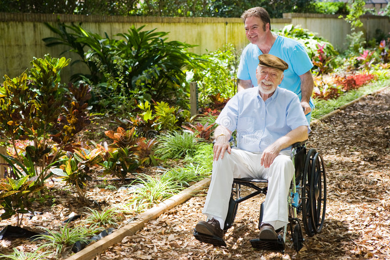 Disabled Senior Enjoying Garden stock image