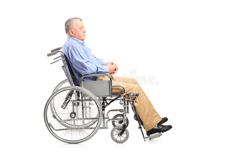 A disabled senior man posing in a wheelchair