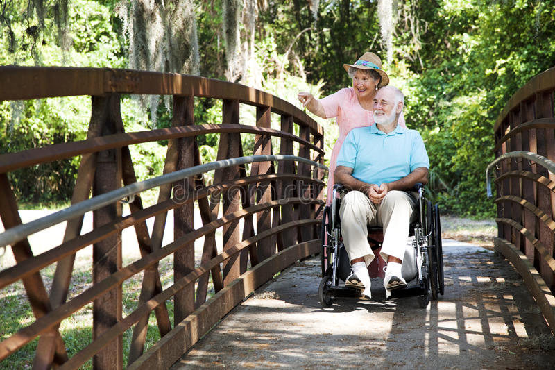 Disabled Seniors in Park royalty free stock photos