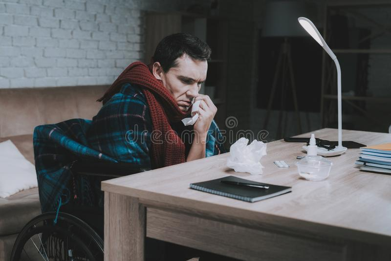 Disabled Sick Young Man on Wheelchair at Home. royalty free stock image