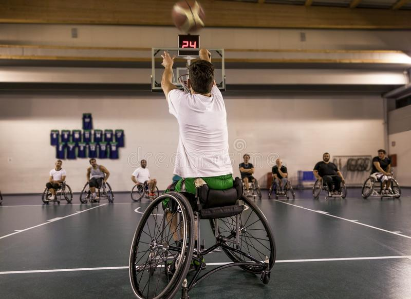 Disabled sport men in action while playing basketball royalty free stock images