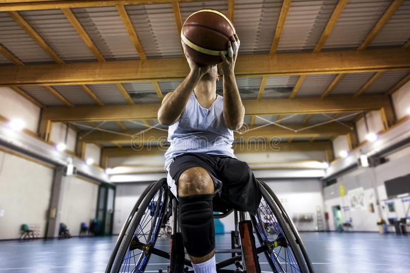 Disabled sport men in action while playing indoor basketball royalty free stock photography