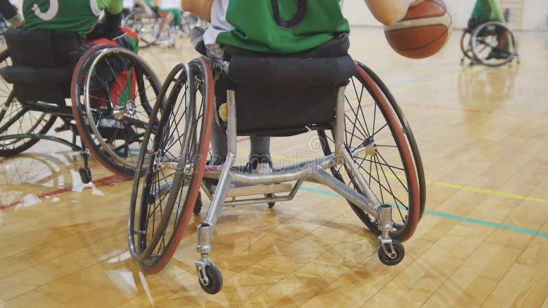 Disabled sportsmen plays wheelchair basketball stock photo