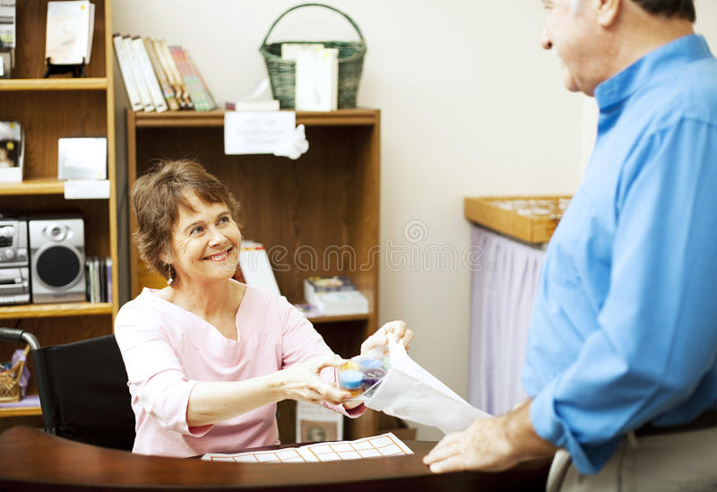 Disabled Store Clerk Stock Photos