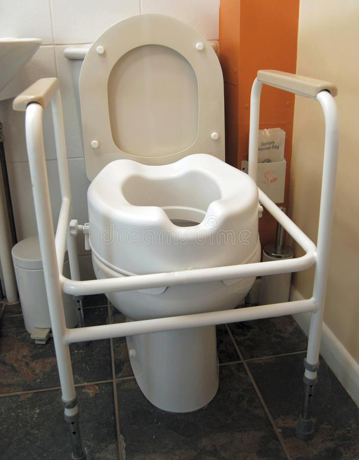 Disabled Toilet With Handles And Raised Seat Stock Photo - Image of ...