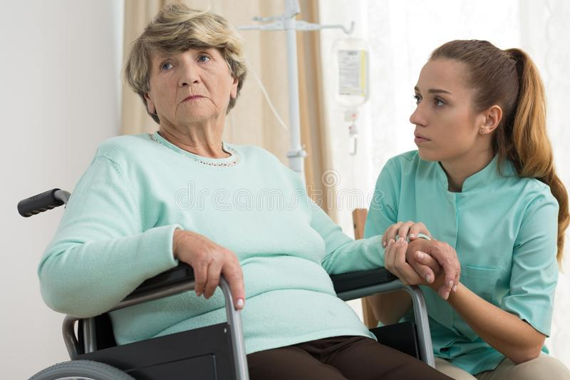 Disabled woman in care home. Disabled sad women living in care home royalty free stock photography