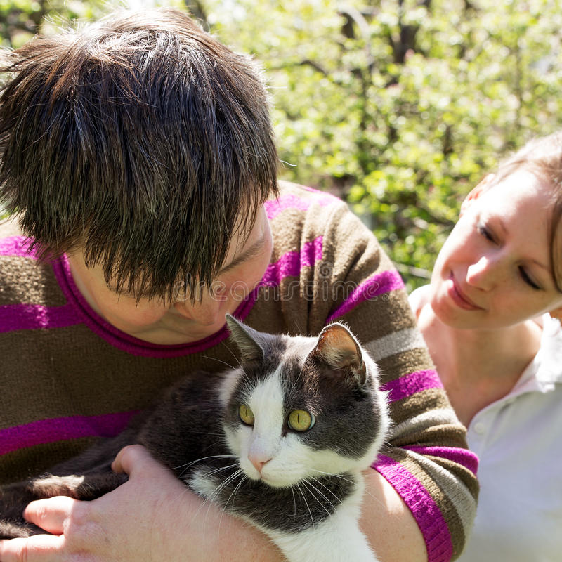 Disabled woman cuddles a cat. Disabled women cuddles a cute cat royalty free stock image