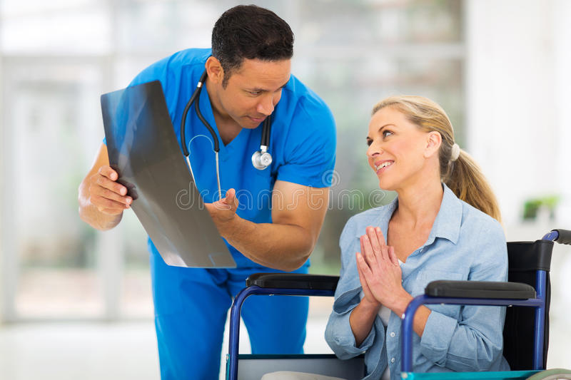 Disabled woman doctor. Senior disabled women begging doctor for help royalty free stock photo