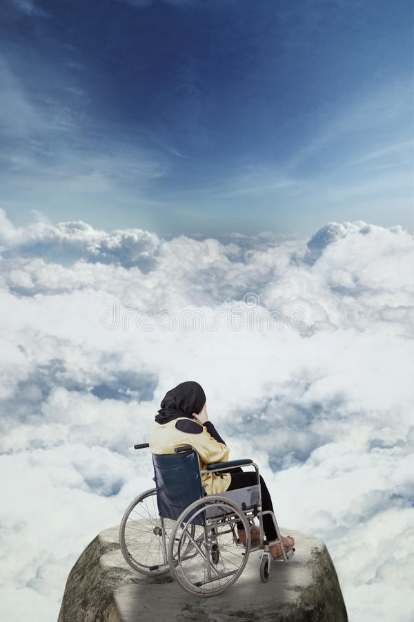 Disabled woman looks depressed on the mountain royalty free stock image