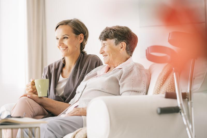 Disabled woman with a nurse stock photography