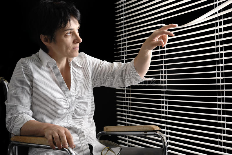 Download Disabled Woman In Wheelchair Looking Trough Blinds Stock Image - Image: 14753871