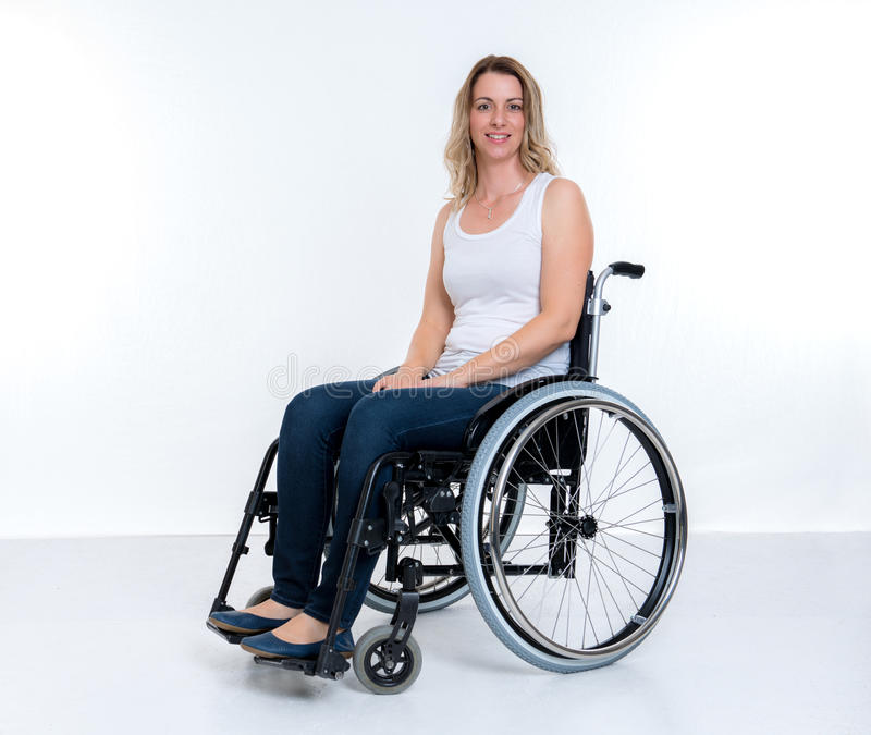 Disabled woman in wheelchair royalty free stock images