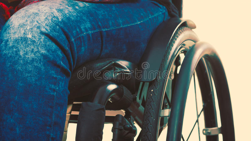 Disabled young girl on wheelchair. stock image