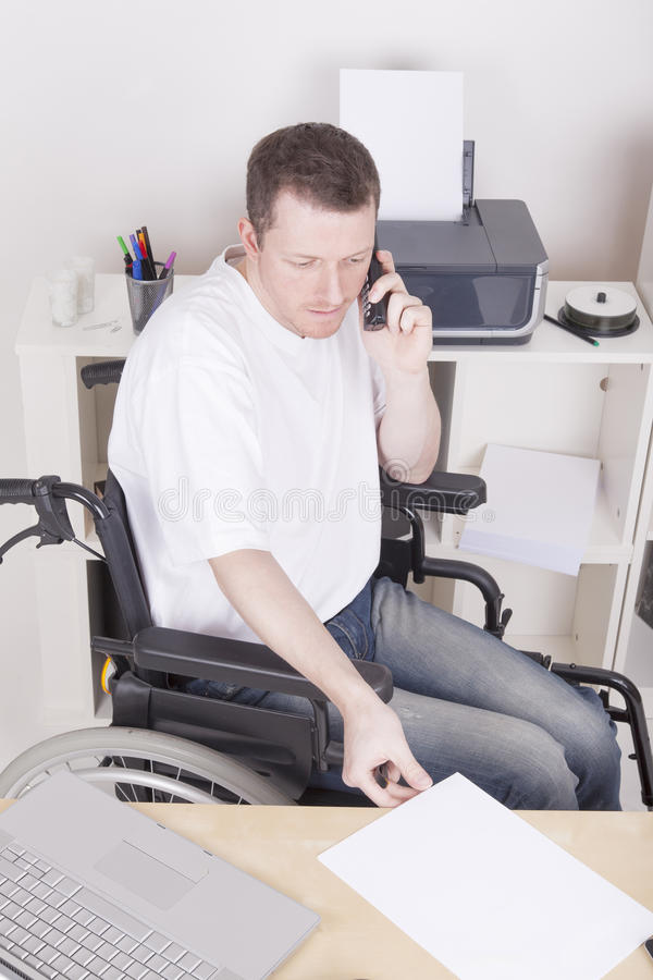 Disabled young man at the office stock photos