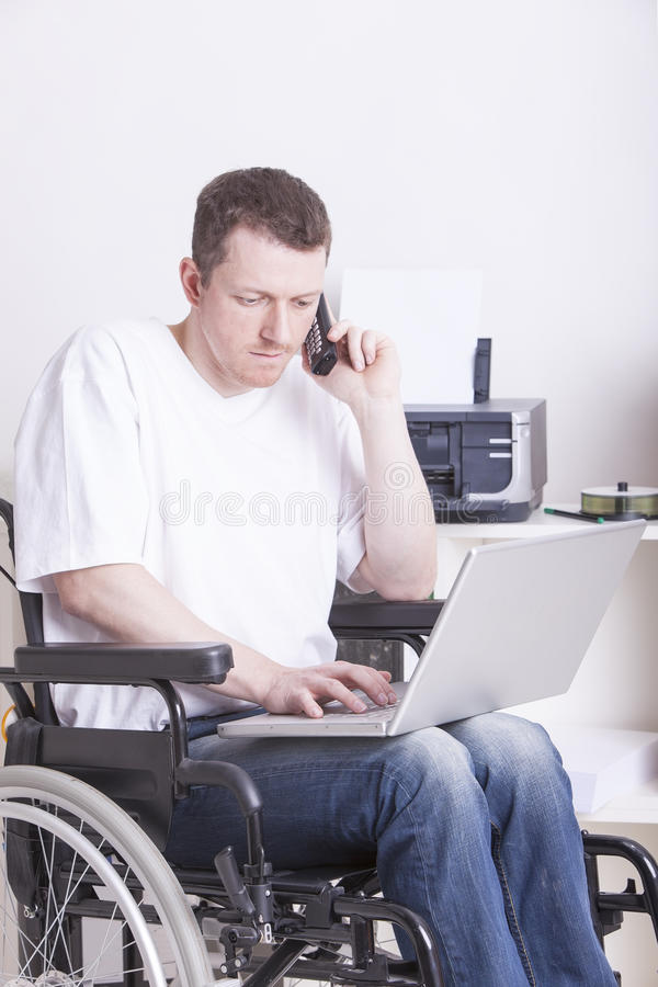 Download Disabled Young Man At The Office Royalty Free Stock Images - Image: 29350719
